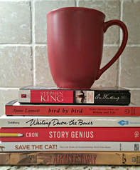 Mug on top of writing craft books