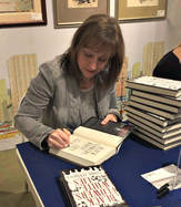 Yvonne signing at Books of Wonder